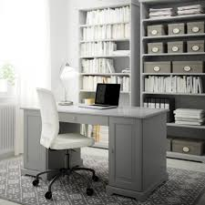 office furniture ikea. a home office with grey desk bookcases and swivel chair white cotton furniture ikea