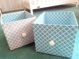 turquoise and gray diy storage bins made from cardboard boxes for nursery changing table