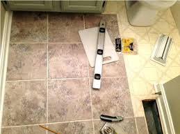 adhesive kitchen floor tiles how to install vinyl tile flooring on kitchen floor tiles self