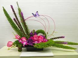 laitris roses orchids with fox tail fern bandelino twigs