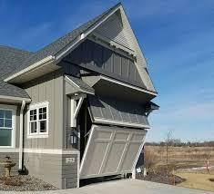 16 ft tall rv garage door has ingenius design to appear half its height hydraulic doors