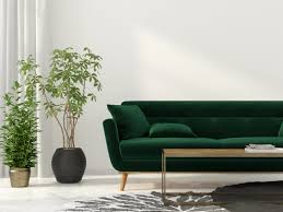 green modern sofa and charcoal and ivory rug in the living room