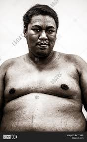Fat Naked Upper Body And Belly Stomach Of An African Tribal Man.