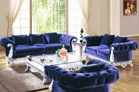posh navy blue velvet sofa set with silver frame and large glass top coffee table