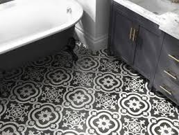 black and white tile floor. Bathroom Floor Featuring Patterned Black And White Tile. Tile