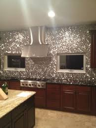 kitchen backsplash stainless steel tiles: river rock pattern mosaic stainless steel tile this is a little overdone for my tastes
