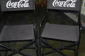 two vintage black directors chairs café list coca cola 1989