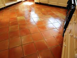 terracotta tiled floor in a kitchen after cleaning and sealing