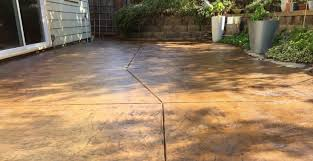 refinished concrete patio using surecrete sealer and stain