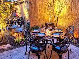 nestled in a brownstone along lenox avenue chéri a french inspired restaurant boasts a beautiful backyard garden patio the plant filled patio is nothing