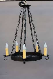 simple round wrought iron crystal chandelier with hanging black chairs and lamp holder ideas