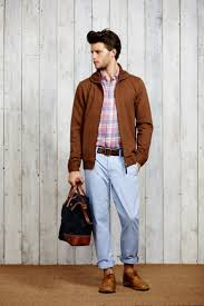 rock a brown er with light blue casual pants to get a laid back yet