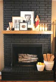 how to paint fireplaces brick fireplace painted a dark gray almost black with wood mantel and how to paint fireplaces