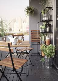 balcony furniture ideas. A Small Balcony Furnished With Foldable Table And Three Chairs, All In Solid Furniture Ideas