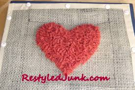 outline the edge of the rug shape using white wool strips