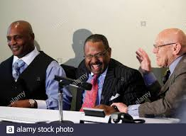 L - R) Nathaniel Claybrooks shares a laugh with his co-counsels Byron  Perkins and Cyrus Mehri