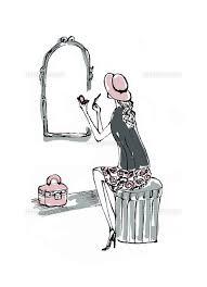 鏡の前で化粧する帽子を被った女性