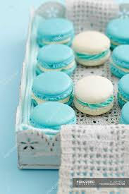 turquoise french macarons in wooden tray stock photos