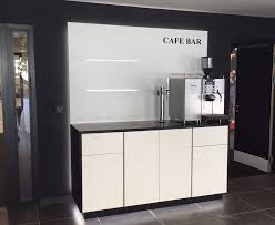office coffee stations. white and black coffee point with glass worktop led illuminated plinth rear back panel office stations y