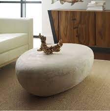 The cheapest offer starts at £15. Fosters Furniture Phillips Collection River Stone Roman Large Coffee Table