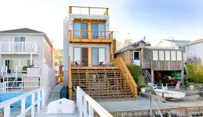 bronx box prefab turns a narrow lot into a home with breathtaking bay views