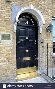front door tavernBlack painted front door St Johns Square Marjory Warren House