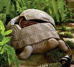 garden hose storage pots this decorative turtle pot is crafted from all weather faux stone and garden hose