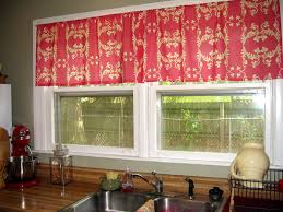 pink kitchen window curtains for old fashioned white framed windows above long kitchen counter