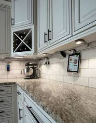 under cabinet plug in lighting. outlets below upper kitchen cabinets plug in lights drop down tablet cradle centsational under cabinet lighting e