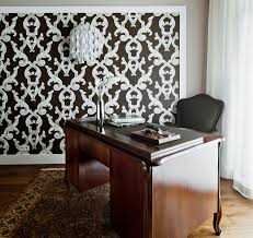 a home office area with a sturdy antique style desk allows for catching up on black and white office design