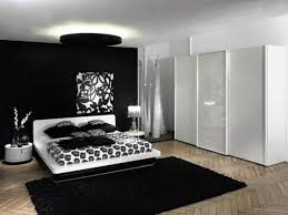 black accent rounded ceiling light over white low profile large size bed frame on black rug and white gloss wardrobe