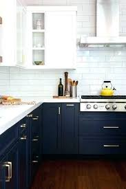 navy and white kitchen blue cabinets with brass hardware subway tile upper rugs red kitche