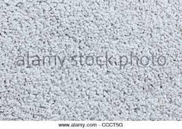 white carpet background. white carpet up close creating a beautiful textured background image. - stock photo e