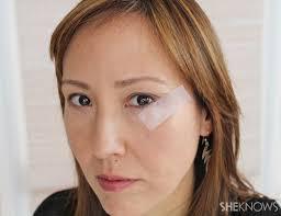 pin tutorial cat eye makeup in teal apply tape