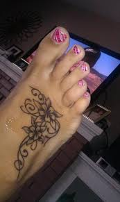 fresh flowers foot tattoo