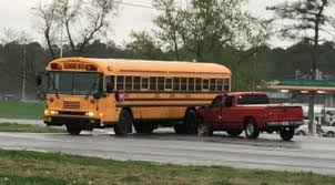 No one injured after a pickup truck hits an empty school bus | Local ...