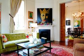 Ornate living room photo in New York with white walls, a corner fireplace  and no