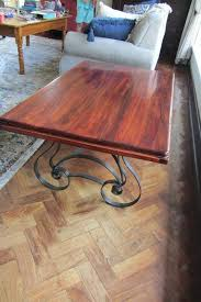 solid dark wood coffee table and cast iron legs