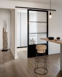 light colored wood cork metal and a black glass sliding door