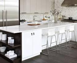 elegant white kitchen island with dark open shelves design croma express kitchens