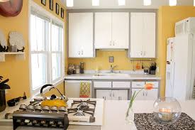 View in gallery Eclectic kitchen in cheerful yellow with a hint of gray  [Photography: Kaia Calhoun]