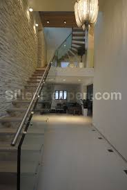 giant structural glass stair, floating treads, stair railing 6meter length  http://