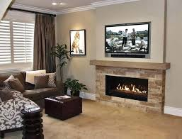 stacked stone fireplace with tv above hang mounting into stone electric fireplace tv