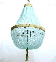 sea glass chandelier blue sea glass chandelier empire nuggets interiors chandeliers french rattan coastal living dining
