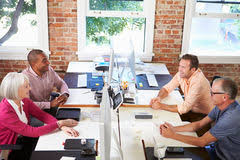 wide angle view busy design office. group of workers at desks in modern design office stock photo wide angle view busy