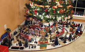 David Smith's 4 x 6-foot O gauge holiday display uses a pie-shaped platform  to run his toy trains under a full-size Christmas tree.