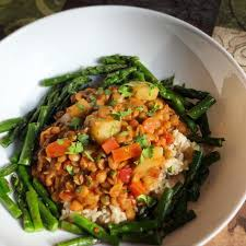 delicious and flavorful lentil stew with roasted asparagus
