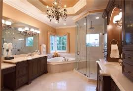 beautiful master bath with traditional chandelier