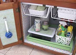 i never thought of attaching those under cabinet racks to the ceiling of cabinet under sink might be helpful bathroom laundry sinks
