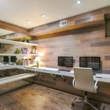 Home Office With Mirror Wall, Floating Shelves, and Long Attached Desk
